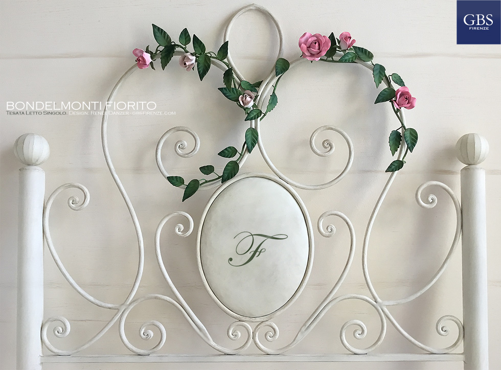 loral Bondelmonti. Wrought iron bed with climbing roses.